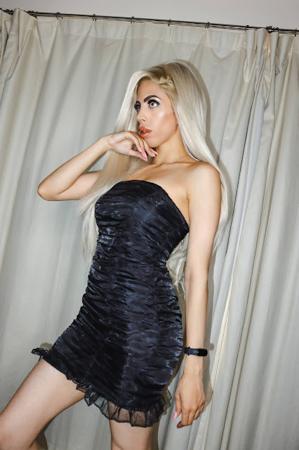 The Femme Luxe Black Ruched Mesh Overlay Strapless Bodycon Mini Dress in model Leonie