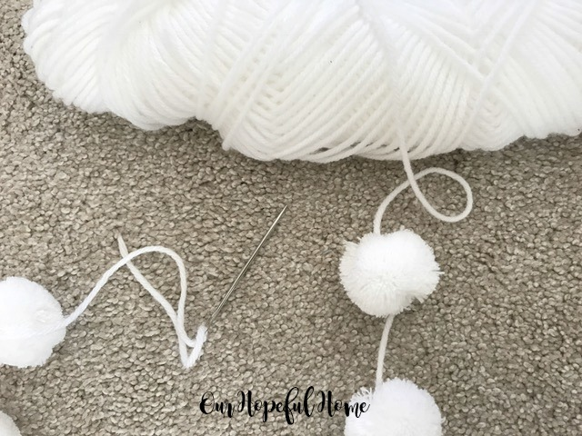 pom pom garland white yarn darning needle