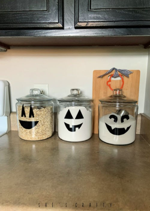 Halloween Home Decor in the kitchen - pumpkin faces on canisters