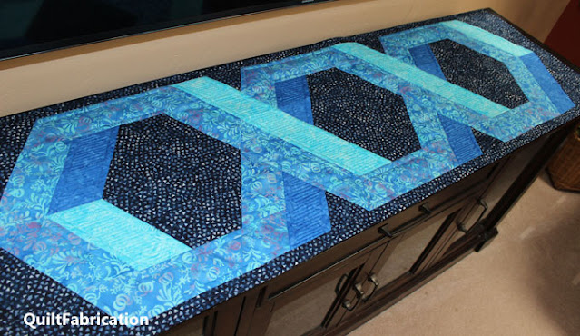 blue and aqua intertwining 3D hexagon table runner
