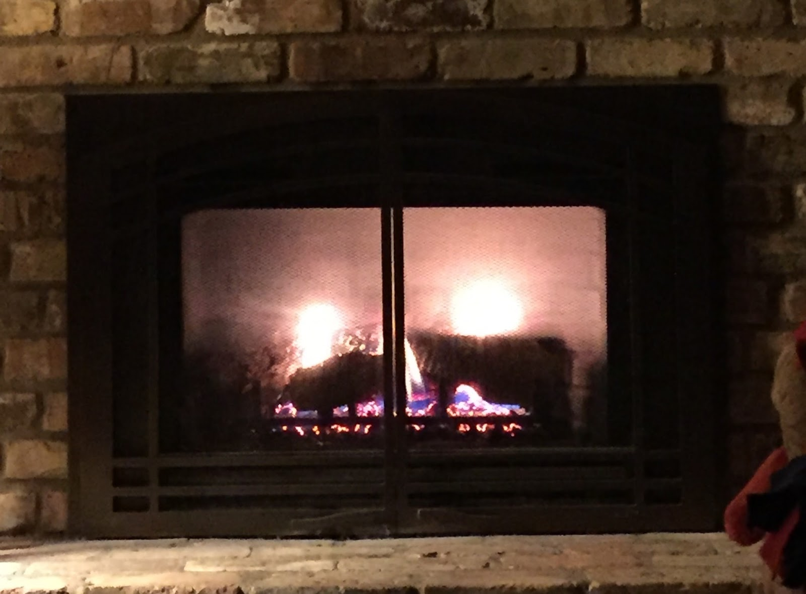 joy2day a fire in the fireplace on a cold winter day