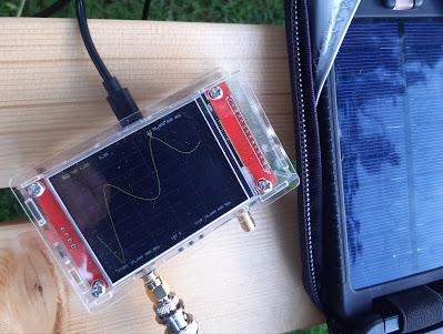 Fig.1 - Measuring the VSWR. The NanoVNA is solar powered using my Solarmonkey.