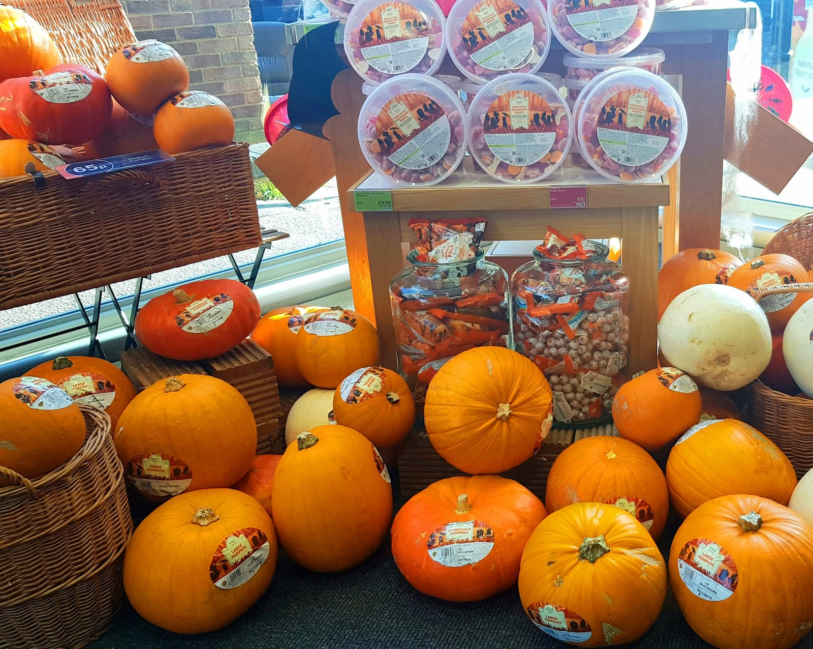 Pumpkin display for Halloween at Marks and Spencer, Epping, England