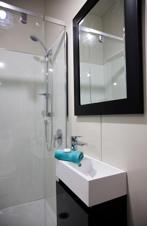 08-Shower-Room-NZ-Tiny-House-Minimalist-and-Space-Age-Architecture-www-designstack-co
