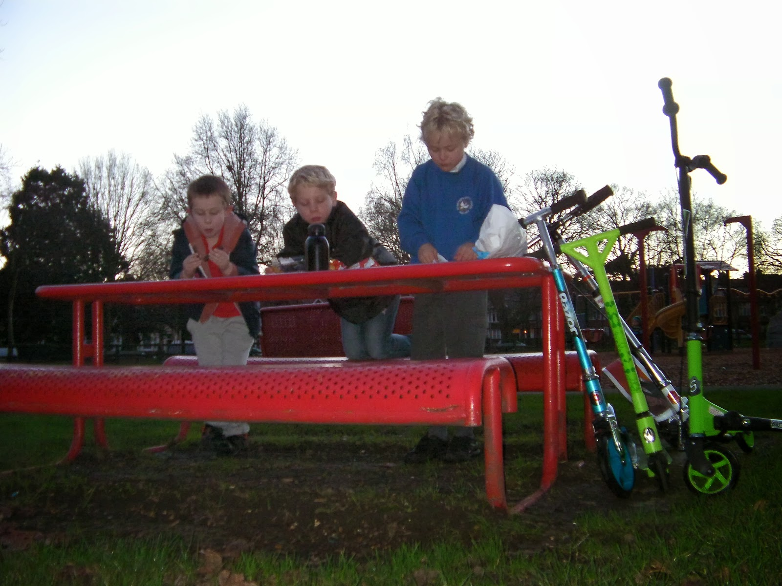 red metal park bench for children
