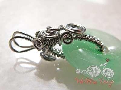 wire wrapped jade donut pendant