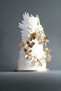 wedding ideas - white three tier cake with flowers - wedding planning - services provided by wedding planners in Philadelphia PA - wedding planners capable - wedding ideas blog by K'Mich