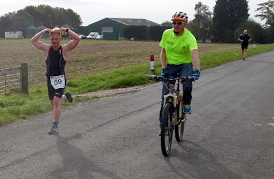 Picture: A competitor in the Keyo Brigg Sprint Triathlon 2018 - held in September - does his Sir Mo Farah impression in the 10k section on Cadney Road - see Nigel Fisher's Brigg Blog