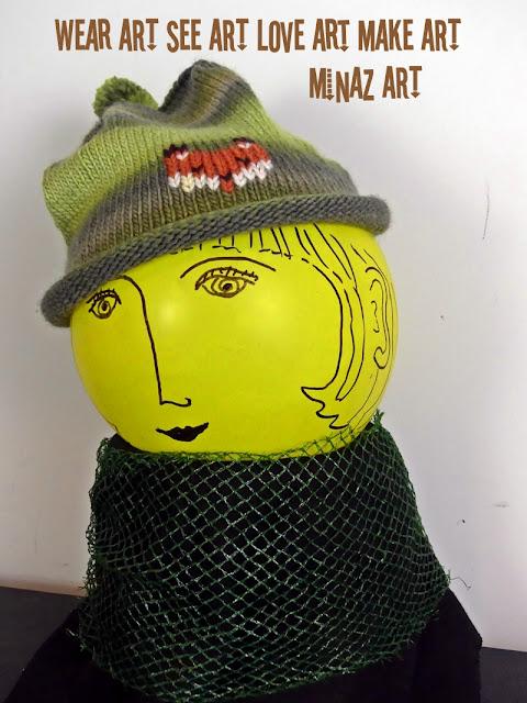 Knit Green Grey Fox Hat designed by Minaz Jantz
