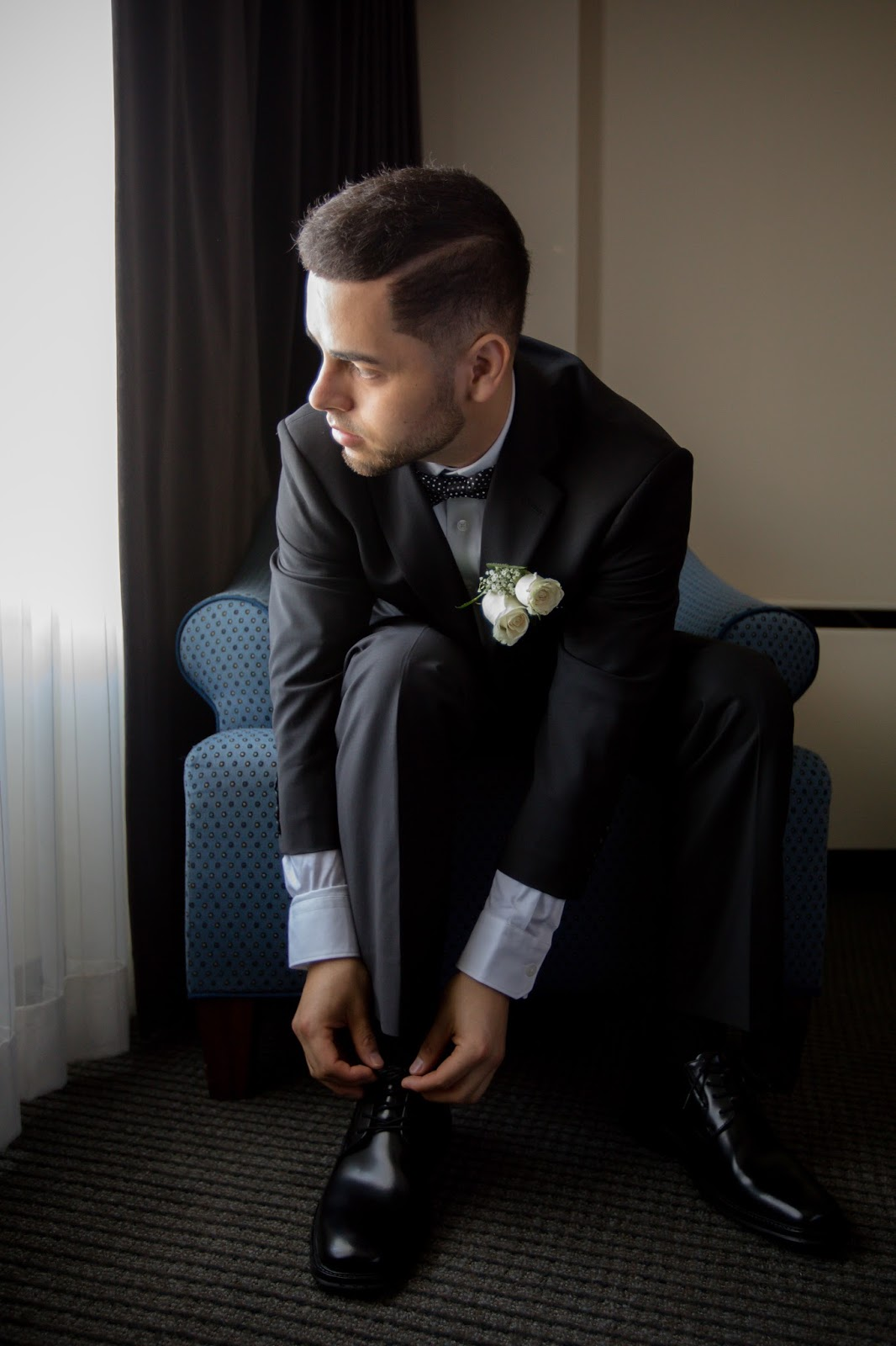 Groom Tying Shoes in Deep Thought