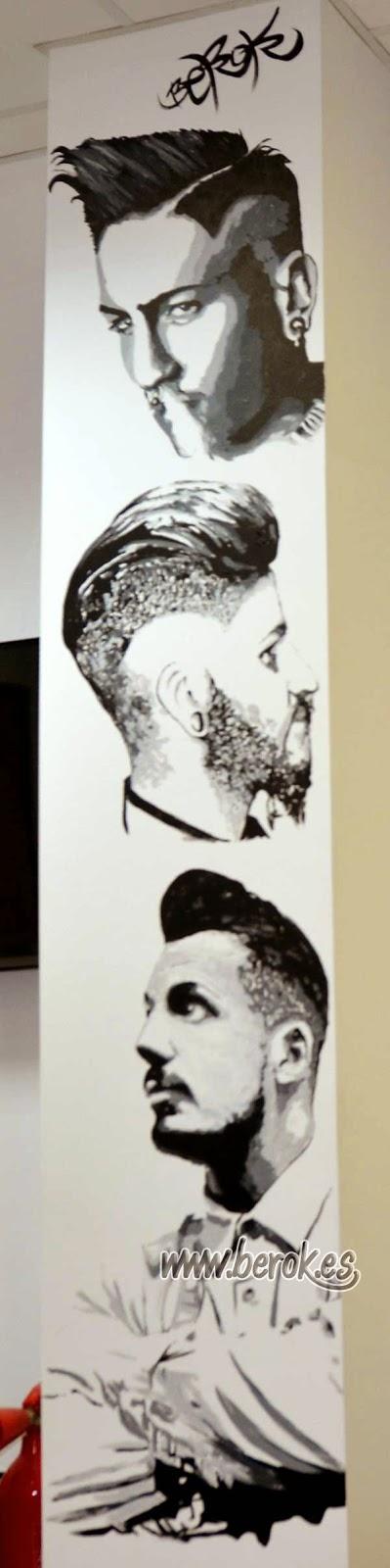 Mural de retratos realistas en columna de barbería