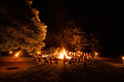 people around a bonfire for storytime