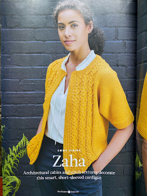 Photo of a model wearing a yellow knitted cardigan which is open at the front