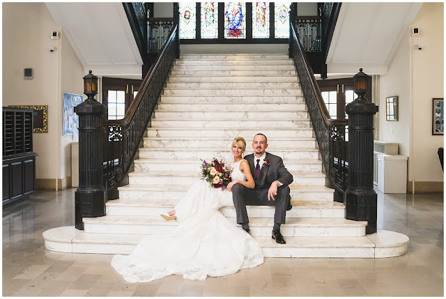 photo of bride and groom on staircase at Le Fer Hall