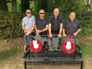 Four of the five cycling pals at the Durham Pals memorial bench (photo David D)