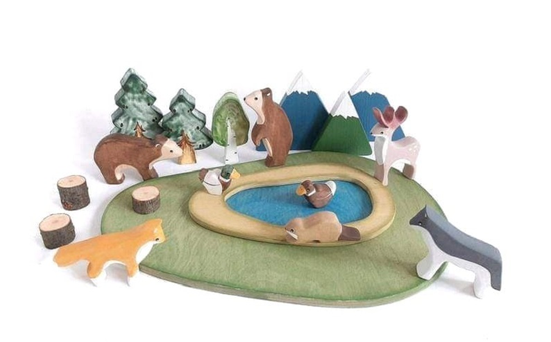 red panda by natali wooden animals, trees and mountains