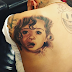 Awww! Chris Brown tattoos Royalty's face on his back