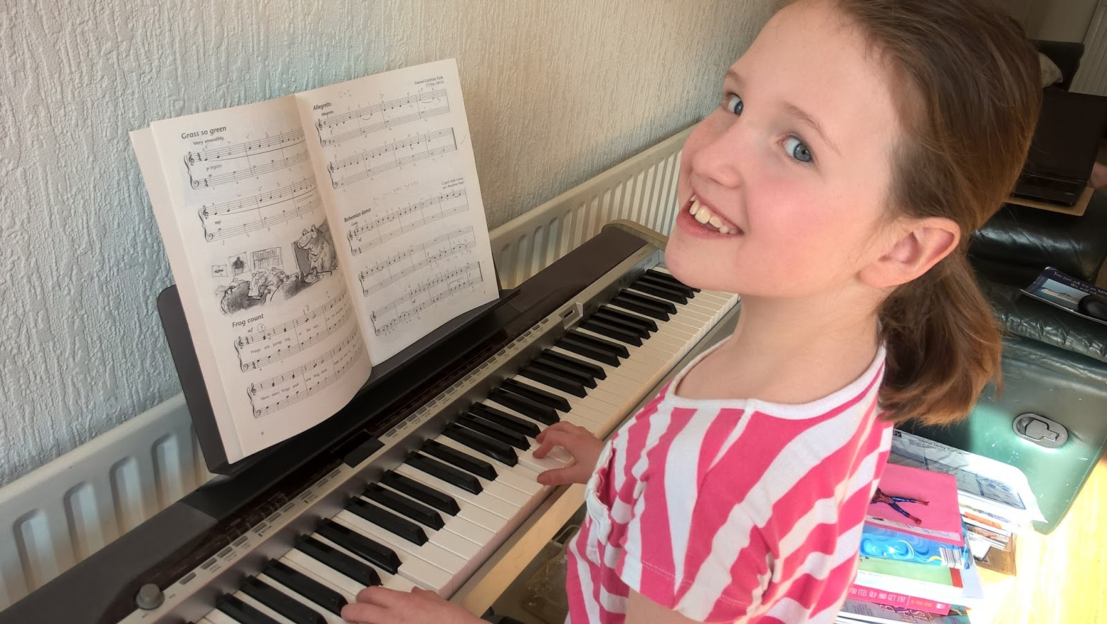 Caitlin Hobbis playing the piano - Surcare Help A Hand Challenge - motherdistracted.co.uk