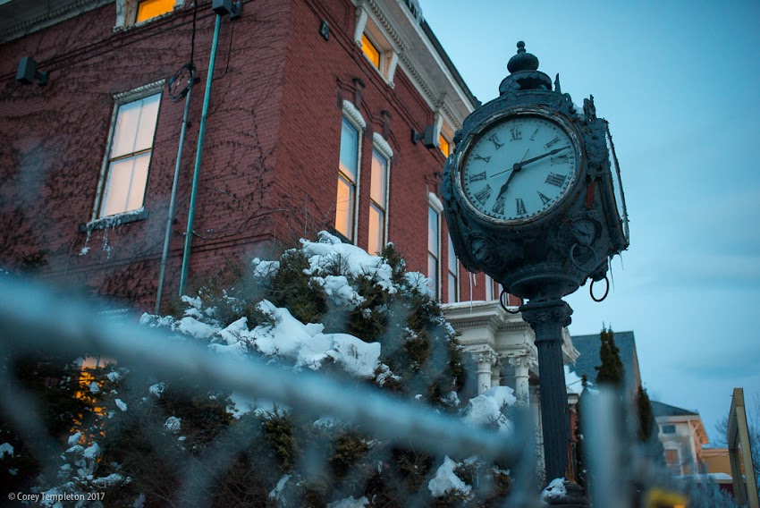 Portland, Maine USA March 2017 photo by Corey Templeton. Looking up at the old clock at 749 Congress Street, in the West End. The building behind it, a former funeral home, has been vacant for years but is currently being redeveloped into a hotel, spa, and restaurant.