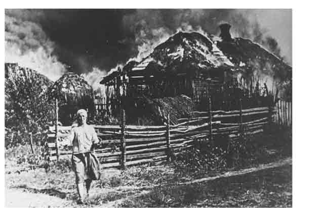 A burning farmhouse in Ukraine, 21 September 1941 worldwartwo.filminspector.com