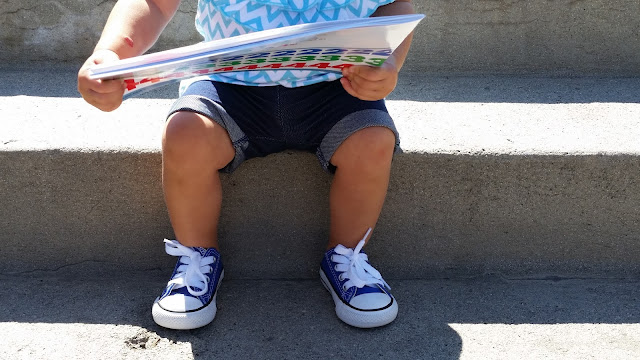 toddler in converse shoes