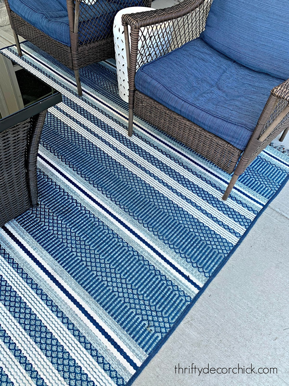 Outdoor rug cleaning with pressure washer