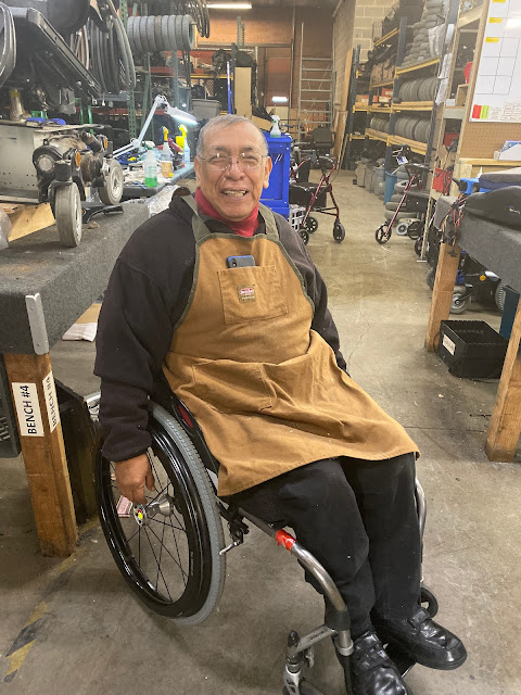 a UATP volunteer smiles from his wheelchair at UATP in SLC