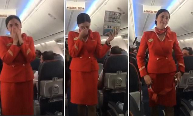 A Russian airhostess broke down in laughter while demonstrating safety measures, thanks to the antics of football fans.  As the Aeroflot airhostess went about making her demonstration, the football fans starting hooting and clapping each of her move.  That initially made the airhostess self-conscious, but later realising that it was all in harmless fun, she broke into laughter, enjoying the scene.