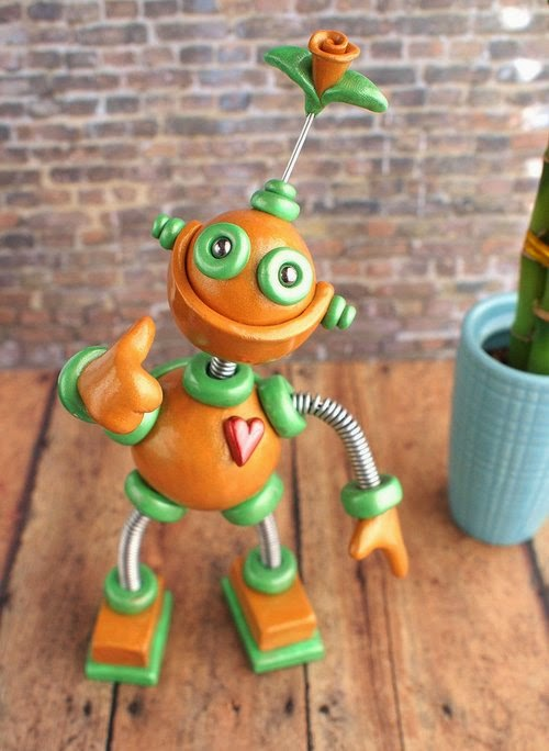 10-Patina-Plexie-HerArtSheLoves-Clay-Robot-World-Sculptures-www-designstack-co