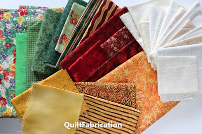 green gold red orange fabrics for a quilt