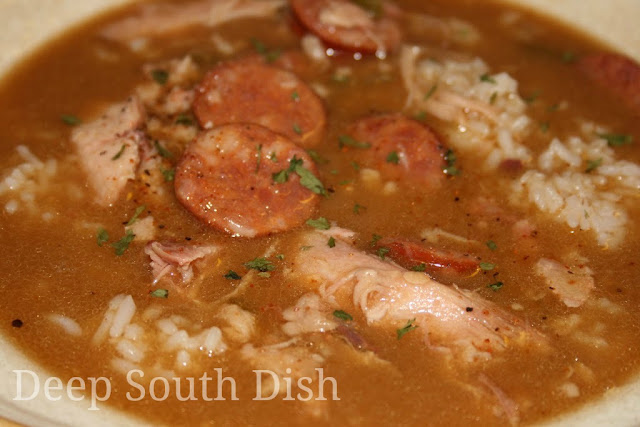 Miss Lucy's Cajun Style Chicken Gumbo - a delicious and easy gumbo made with a roux, the Trinity of vegetables and using a whole chicken and andouille sausage.