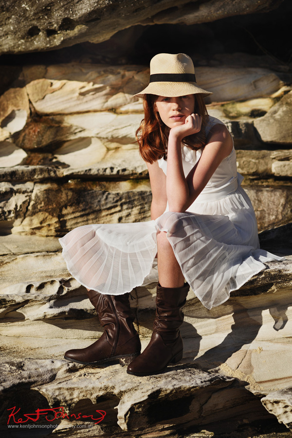 Nat at Nielsen Park Sydney in a white dress, panama and boots for her modelling portfolio photoshoot. Photography by Kent Johnson