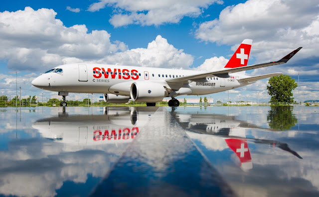 Swiss Global Air Lines Bombardier CS100 on Water Reflection