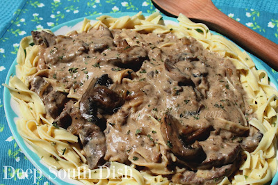 Seasoned cube or sirloin steaks, with onions and mushrooms, in a cream sauce with sour cream on a bed of buttered egg noodles.