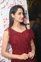 Pragya Jaiswal in Stunnign Deep neck Designer Maroon Dress at Nakshatram music launch ~ CelebesNext Celebrities Galleries 094.JPG