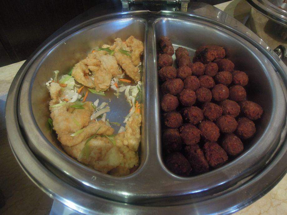 Fish fillet and meatballs in Spice Market's breakfast buffet in Misibis Bay
