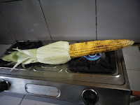 Roasted corn on the gas stove. Some salt, red chilli powder and squirt of lemon juice can make it more flavourful.