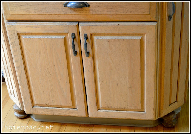 Bun feet added to kitchen cabinets before painting.
