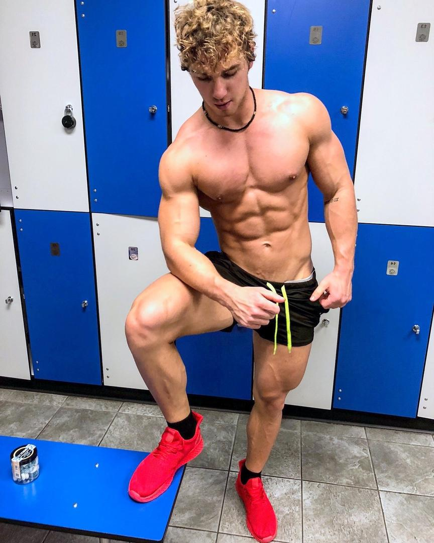 redhead-curly-hair-shirtless-toned-muscle-body-abs-bro-gym-locker-room