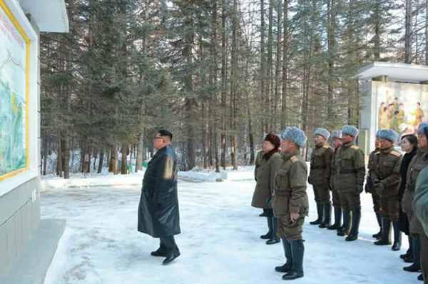 Kim Jong Un looking round Mupho Bivouac
