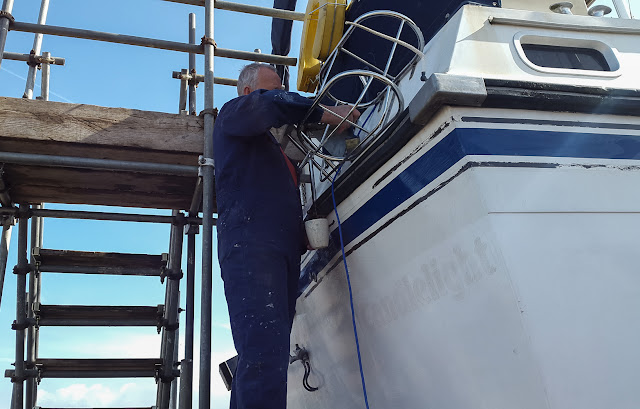 Photo of painting Chine Shine onto the stern