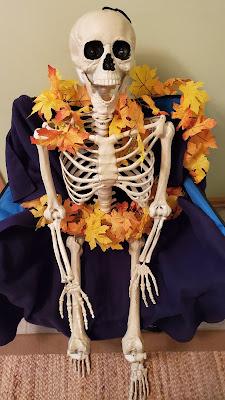 Matilda the Skeleton wearing fall yellow leaves.