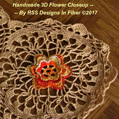 Closeup of one Motif of Table Topper of 3D Orange Yellow Flowers on Tan Lace - By Ruth Sandra Sperling at RSS Designs In Fiber