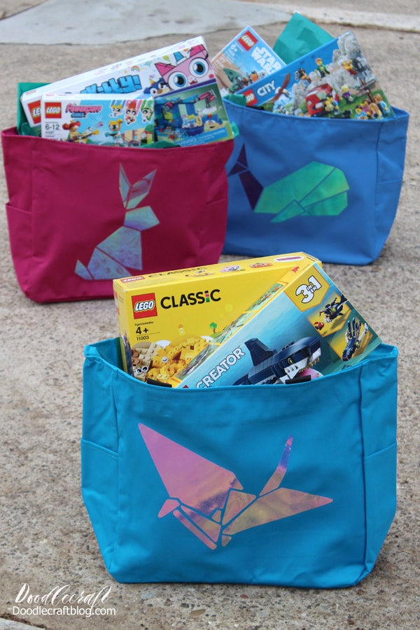 Use the Cricut maker to cut holographic vinyl in origami animal shapes and press them onto tote bags using the EasyPress 2.