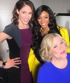 Holly Rowe clicking picture with her co-worker