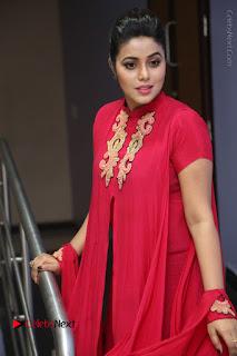 Actress Poorna Latest Stills in Red Dress at Rakshasi First Look Launch  0203.JPG