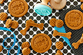 Stamped and shaped homemade dog treats on a black polka dot table cloth