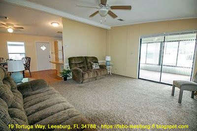 19 tortuga way leesburg FL 34788 living room