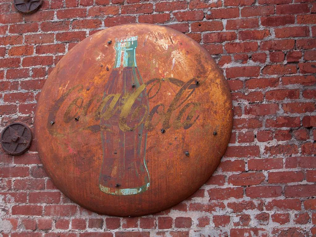 Rusty Coca Cola Sign The Decayed Wall