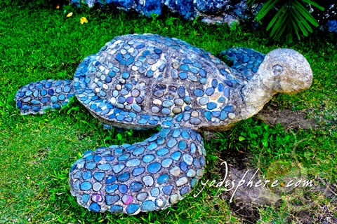 hover_share Stone turtle as one of the garden curio items at the Freedom Park